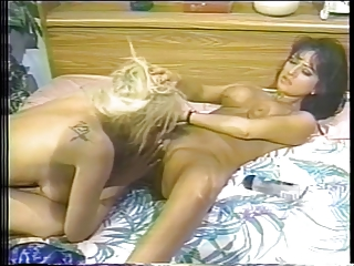 Blonde woman licks her tanned friend's pussy during lesbian sex