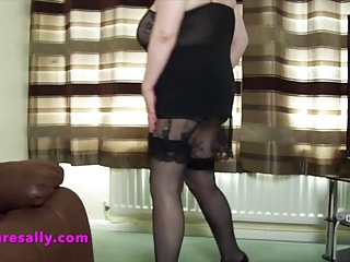Sally in a black slip that shows everything