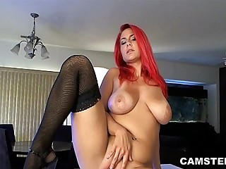 Redhead with big natural tits masturbates on kitchen counter