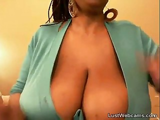 Big titted ebony babe teasing on webcam