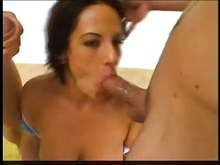 Nasty, sexy slut is giving a double blowjob on two hard cocks