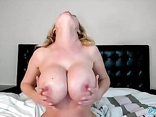 Nikki Benz lathers up her HUGE tits and her trimmed pussy and Masturbates