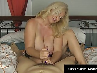 Want your flannel serviced by a horny milf in your bed? The Beautiful Charlee Chase shows off her huge tits as she wraps her expert hands around your hard shaft to make you cum for her!