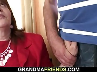 Busty old bitch swallows two cocks