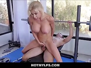 Hot Powerfully built Blonde MILF Hefty Tits Seduces Young Nerd While Working Out