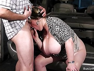 Busty lady swallows boss's cock